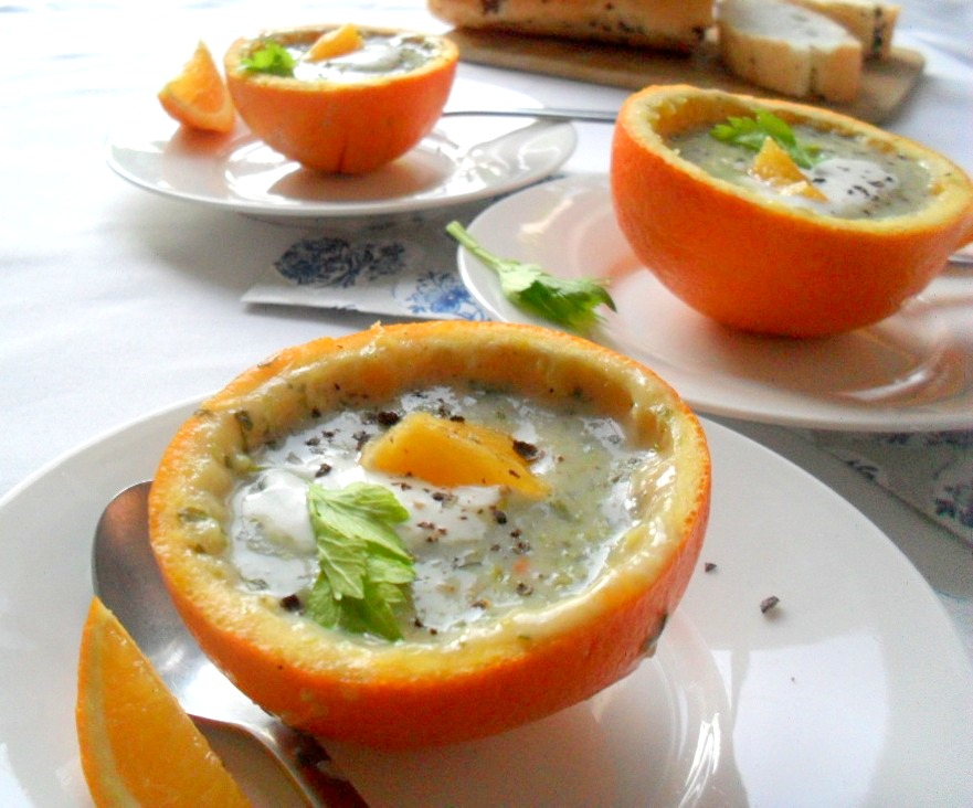 cream of celery and orange soup in orange halves